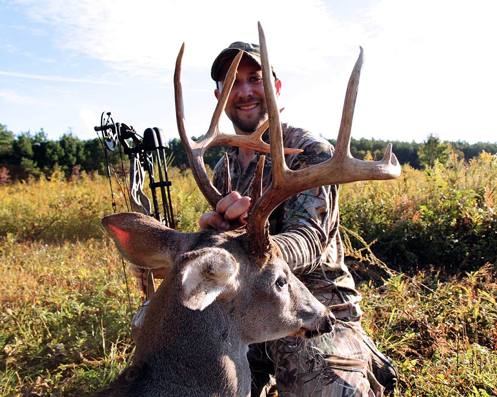 bow hunter with deer in kentucky