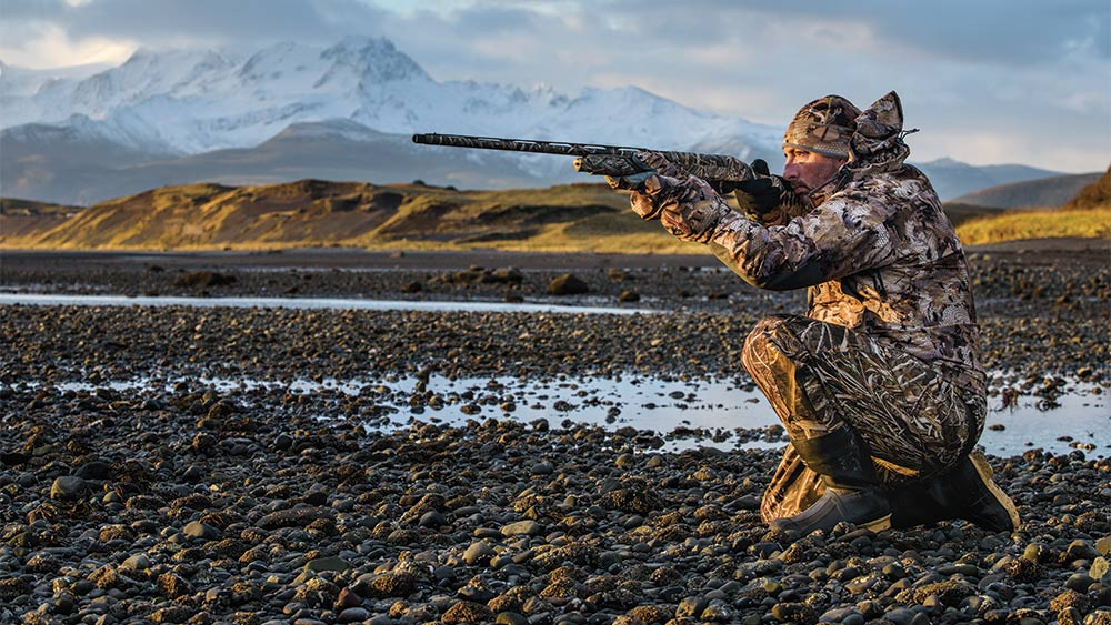 John Snow duck hunting on a rocky beach