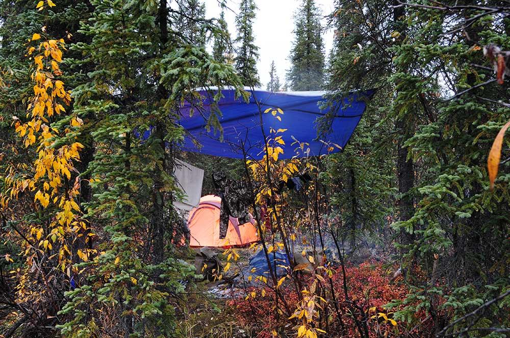 a tarp hanging over a campsite