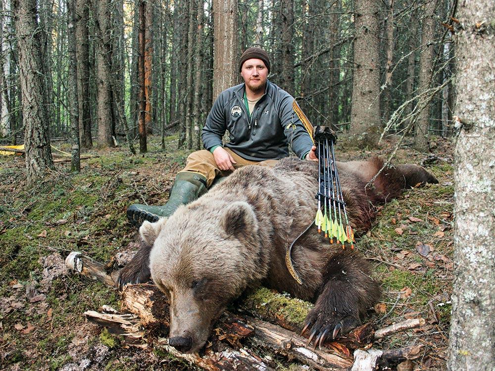 bowhunter next to big alaskan grizzly bear
