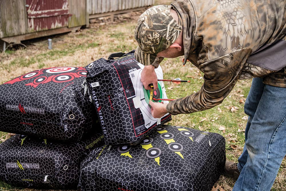 bow hunter measuring target accuracy