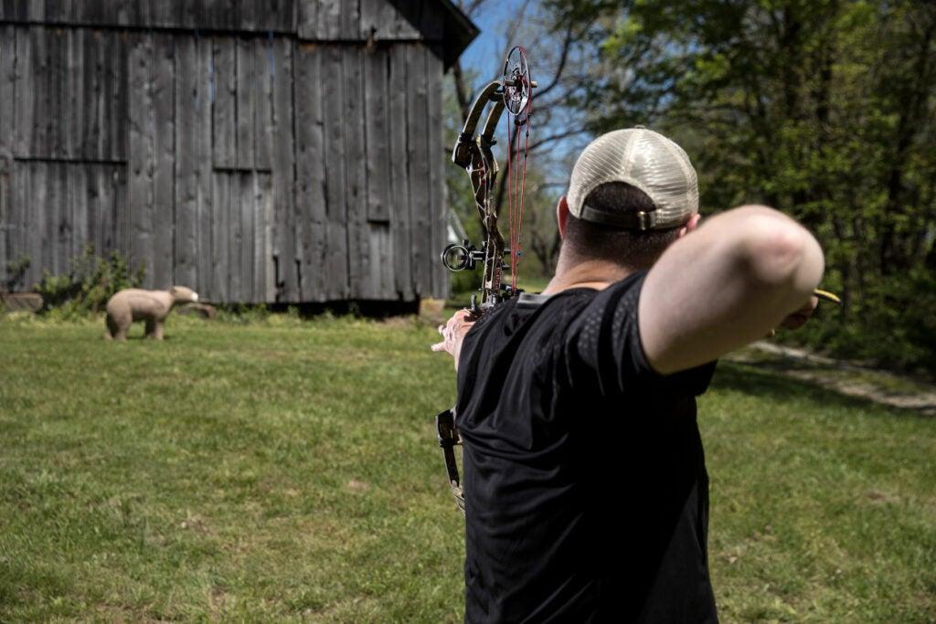 an archer shoots a 3D bear target