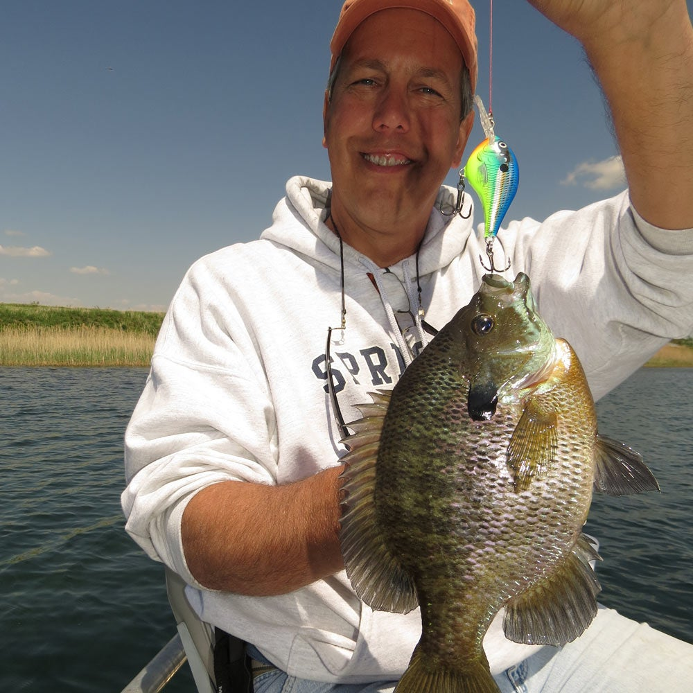 angler with a fresh caught bluegill