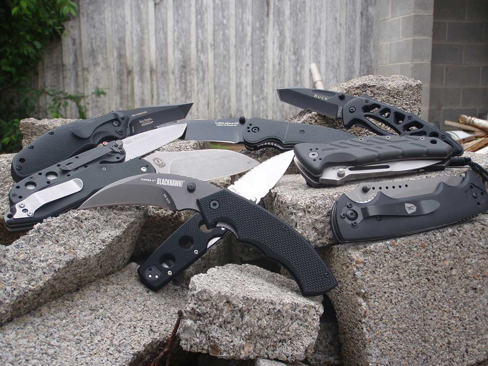 collection of knives sitting on rocks