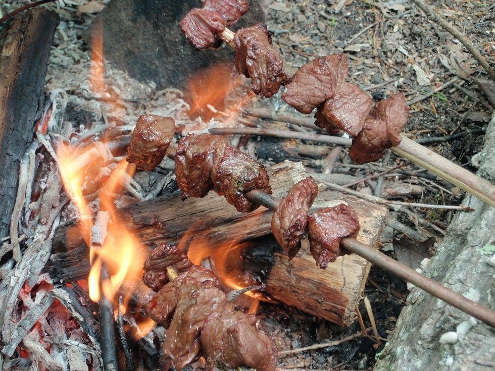 roasting skewer over flames