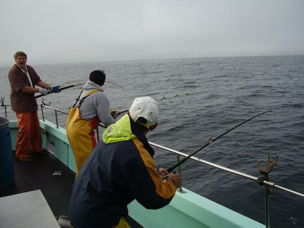 Anglers on a party boat targeting squid