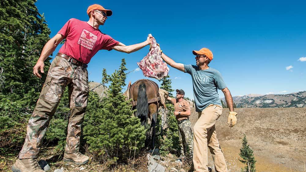 loading deer meat onto horseback