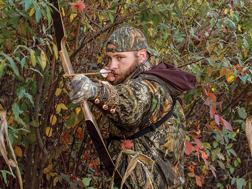 still hunter with recurve longbow