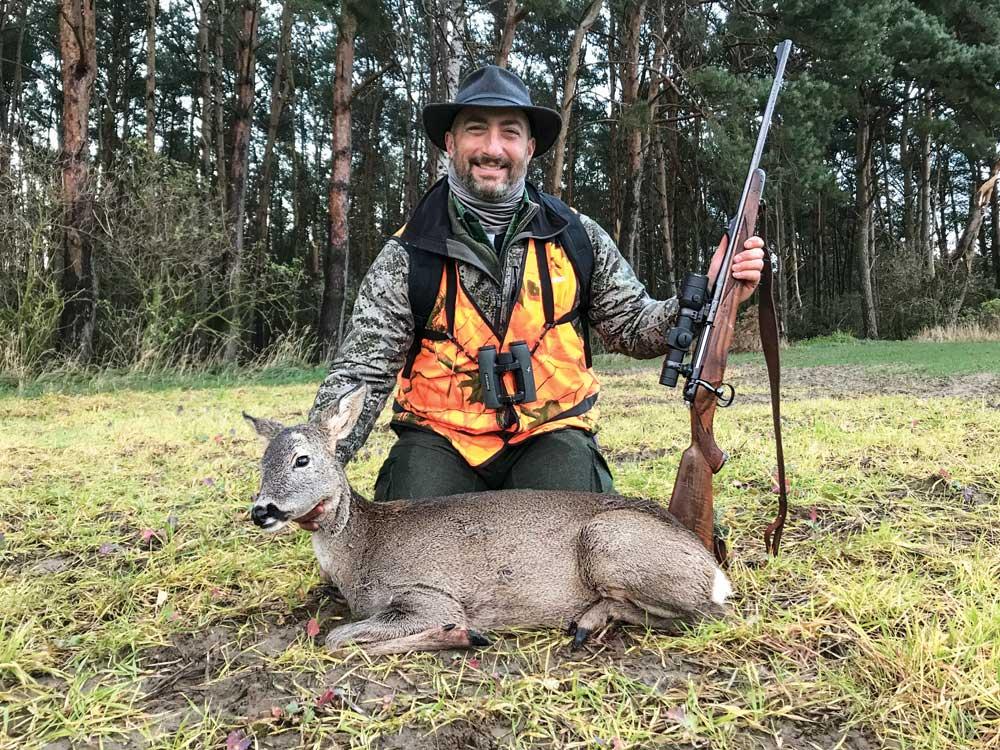 john b. snow next to roe deer hind