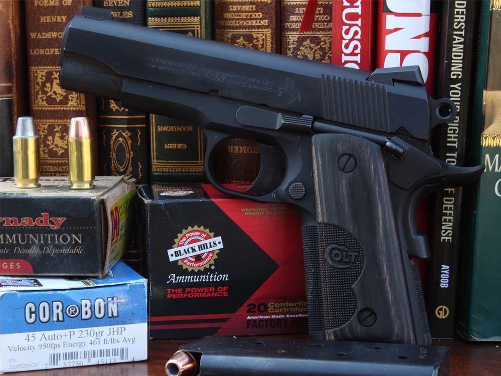 handgun and ammo in front of legal books