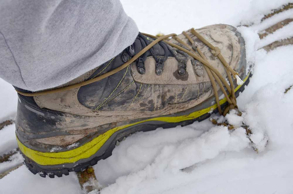 snowshoes attached to boots