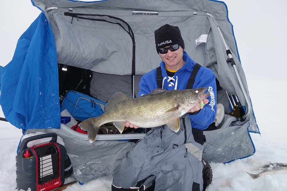 fisherman holding up a walleye