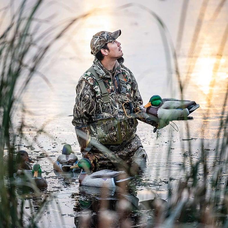alex robinson holding greenhead duck decoy