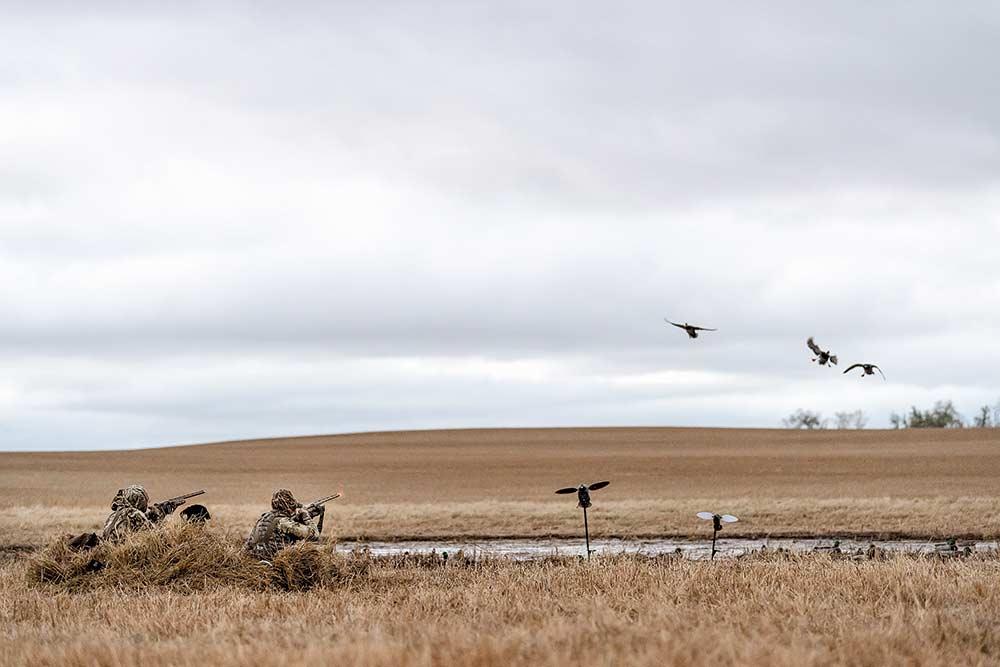waterfowl hunters in a field
