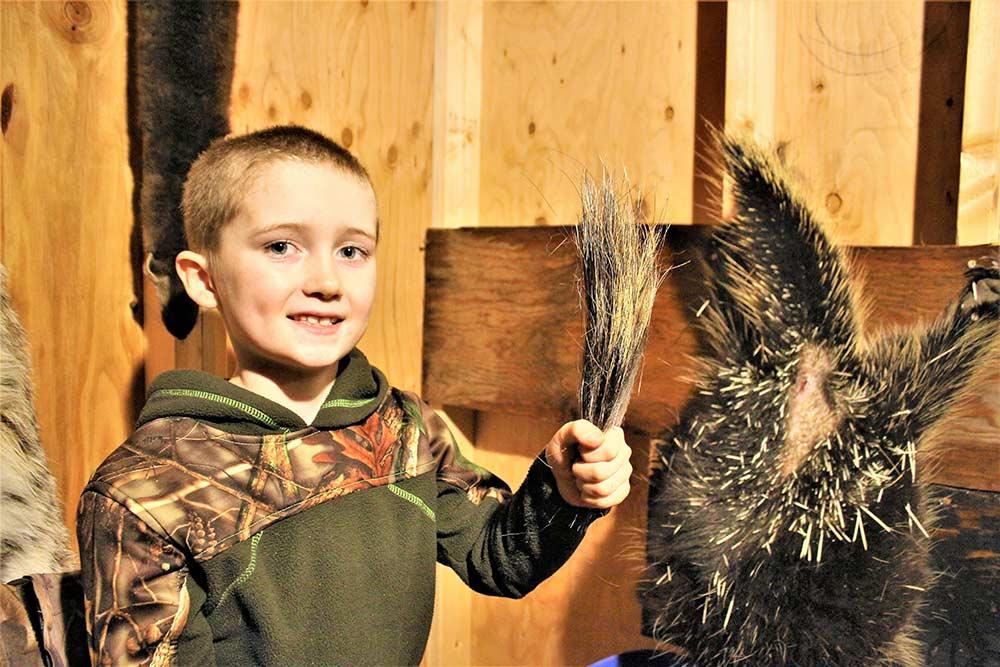 kid holding porcupine quills