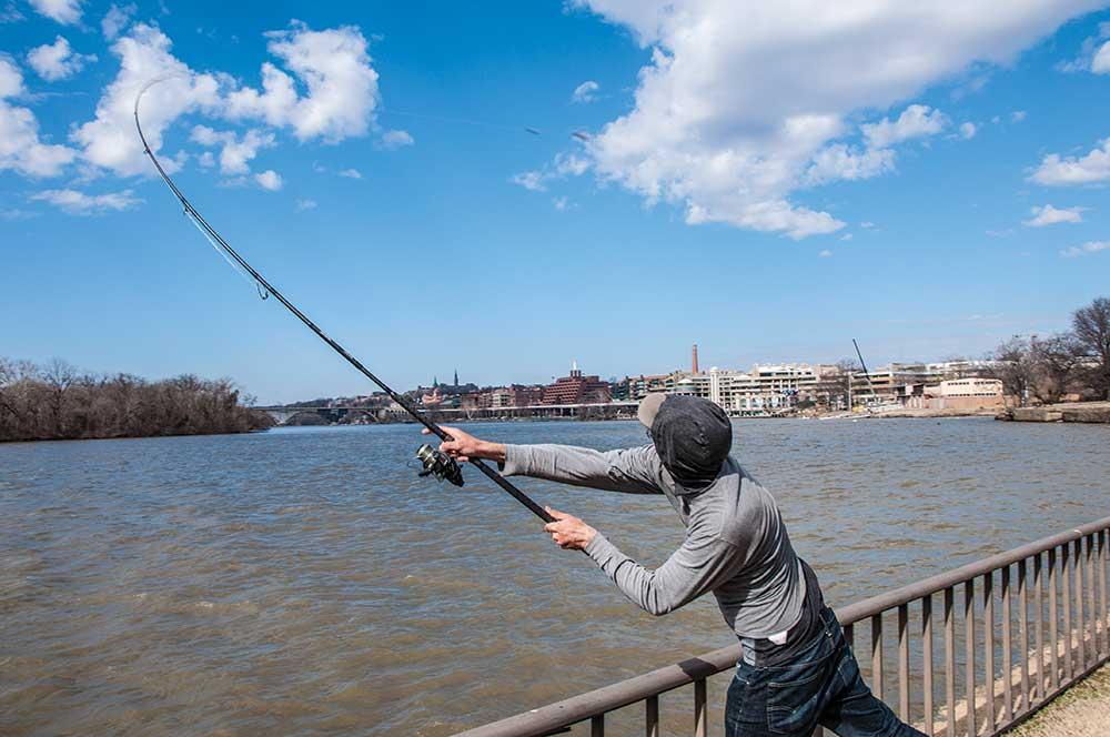 fisherman fishing off a bridge in washington