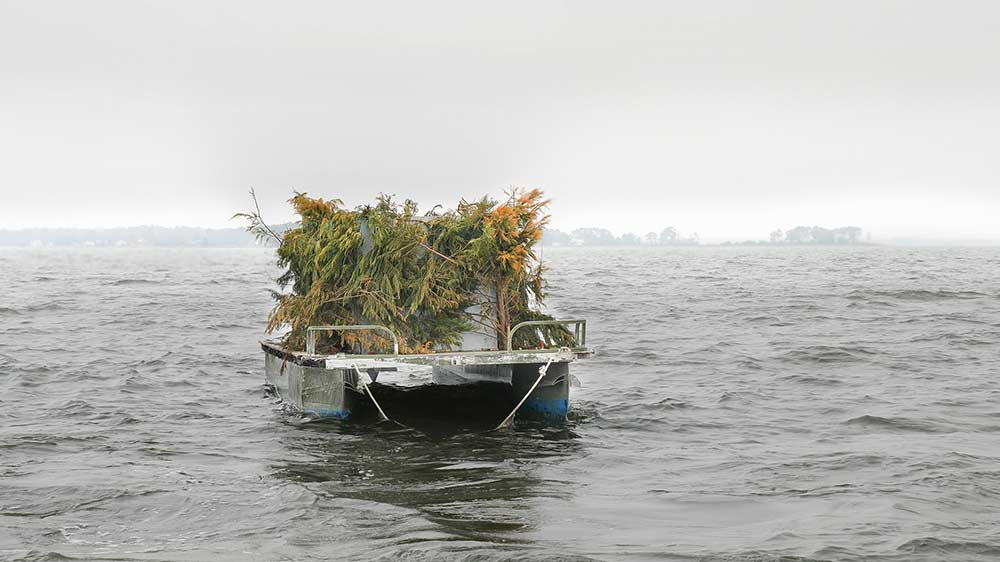 a waterfowl hunting blind on the water