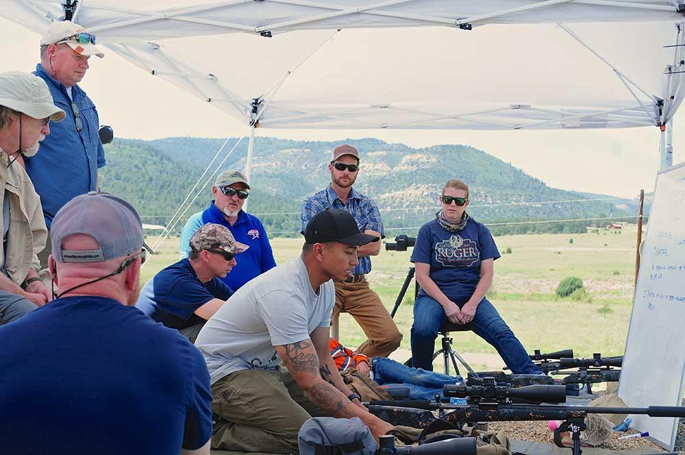 group of men at a long range shooting class