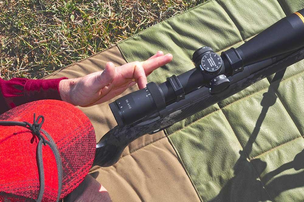 top view of man aiming a long range rifle