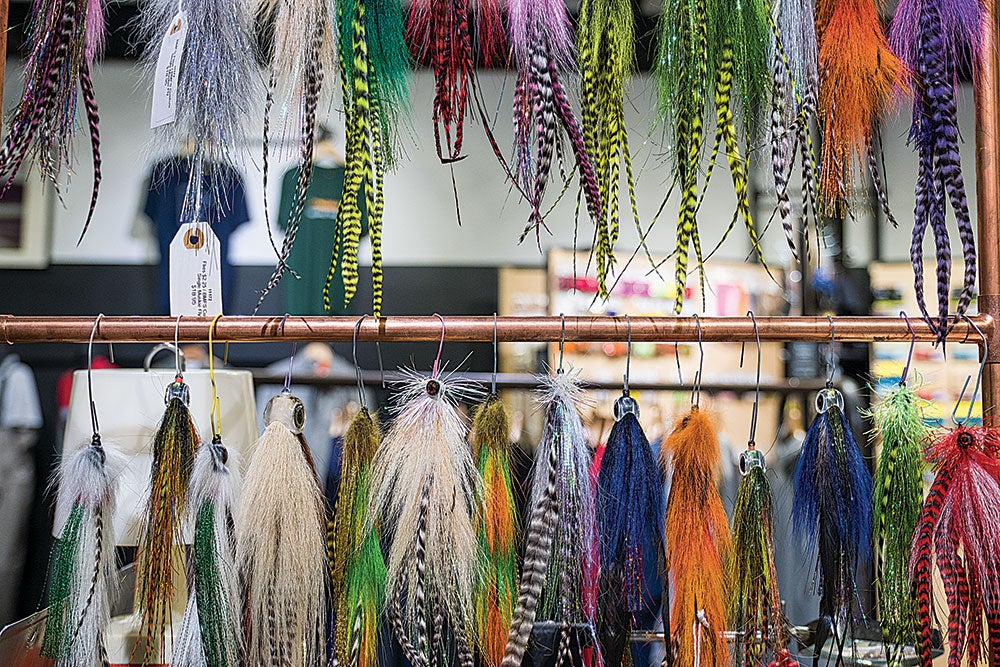 a large selection of custom muskie fly lures on a rack