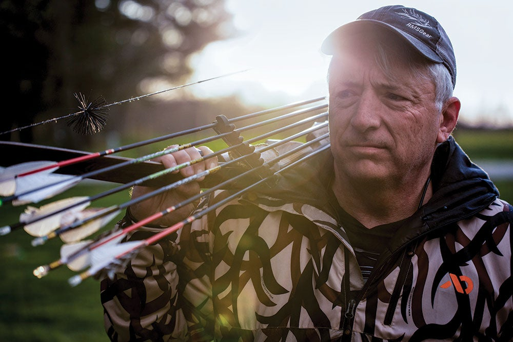 tom clum sr with a bow and arrows slung over his shoulder