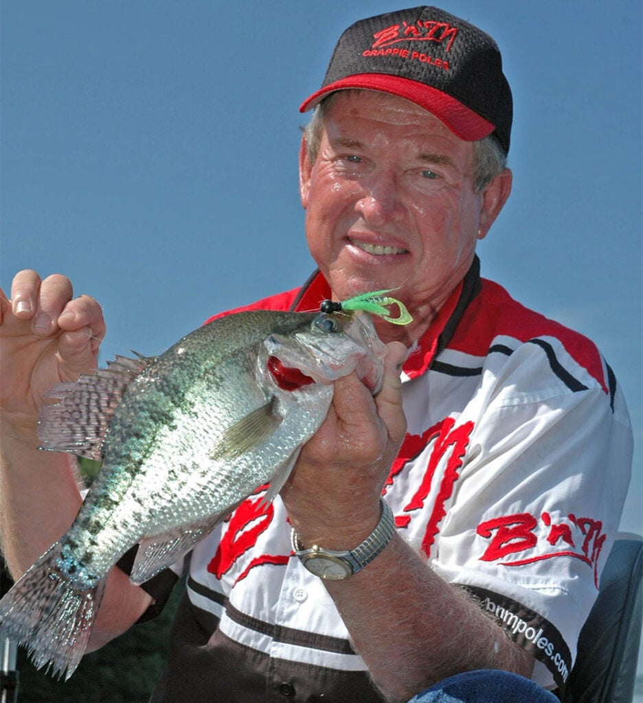 roger gant holding up a crappie fish
