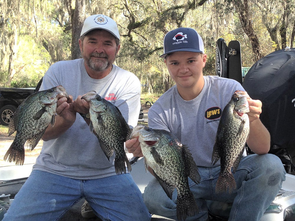 father and son fishing crappies