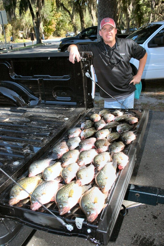 a truck bed loaded with crappie fish