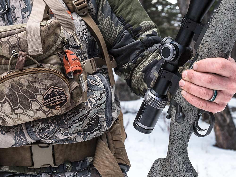 hunter holding a riflescope