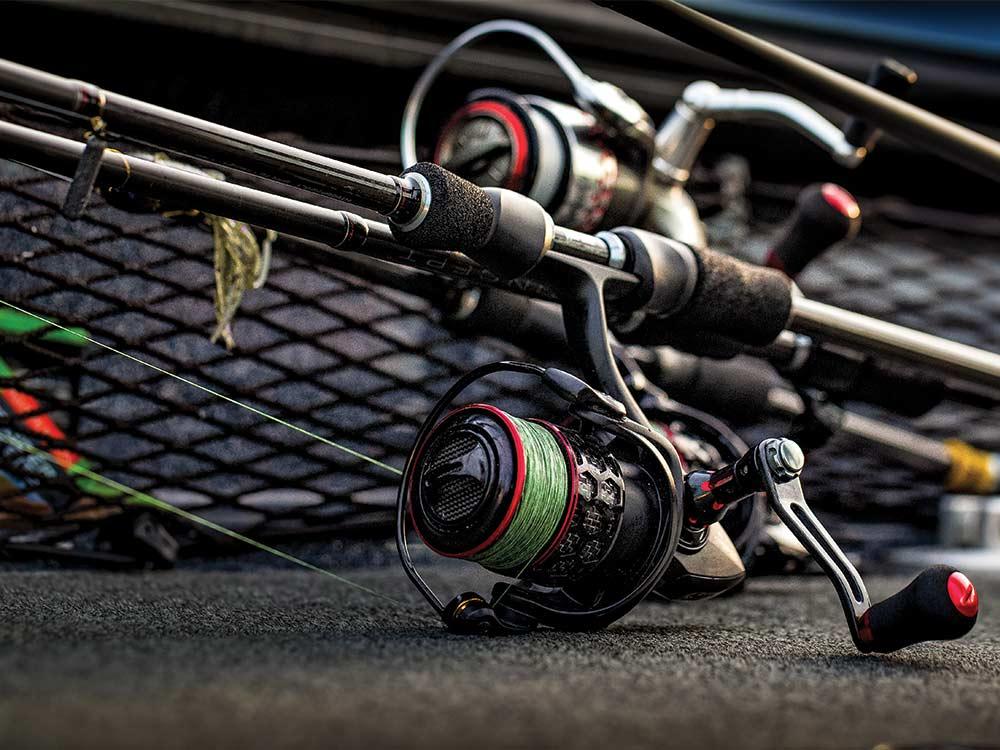 fishing reel resting in a boat deck