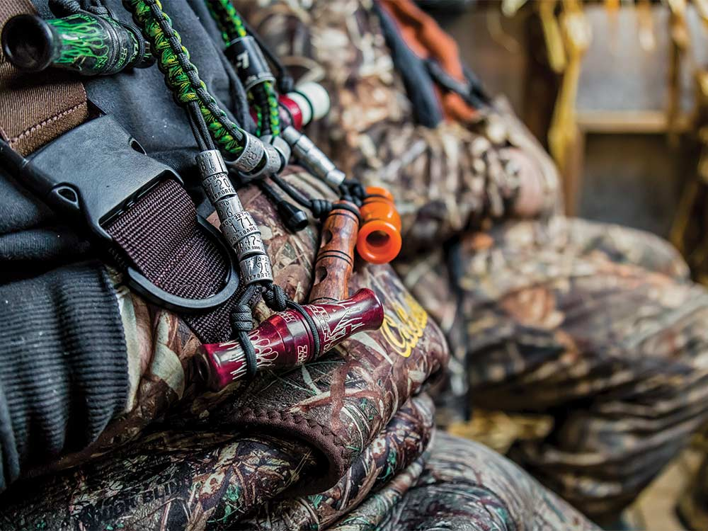 a necklace of duck calls and tags