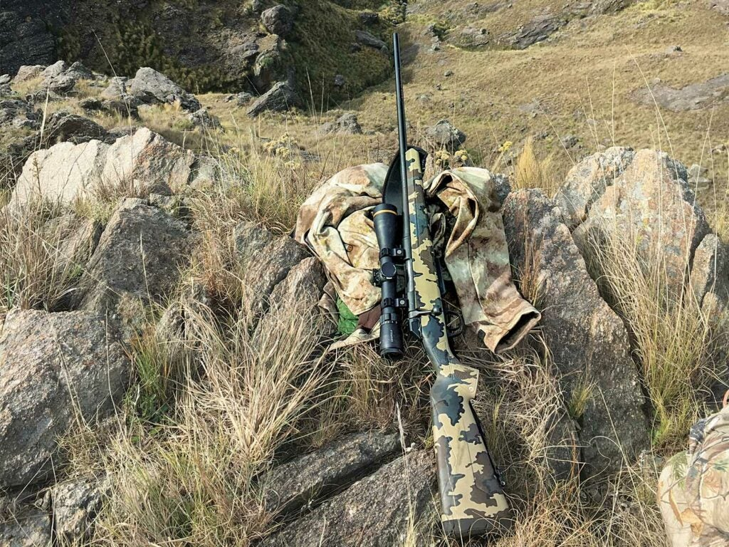 a Winchester xpr rifle leaning against rocks