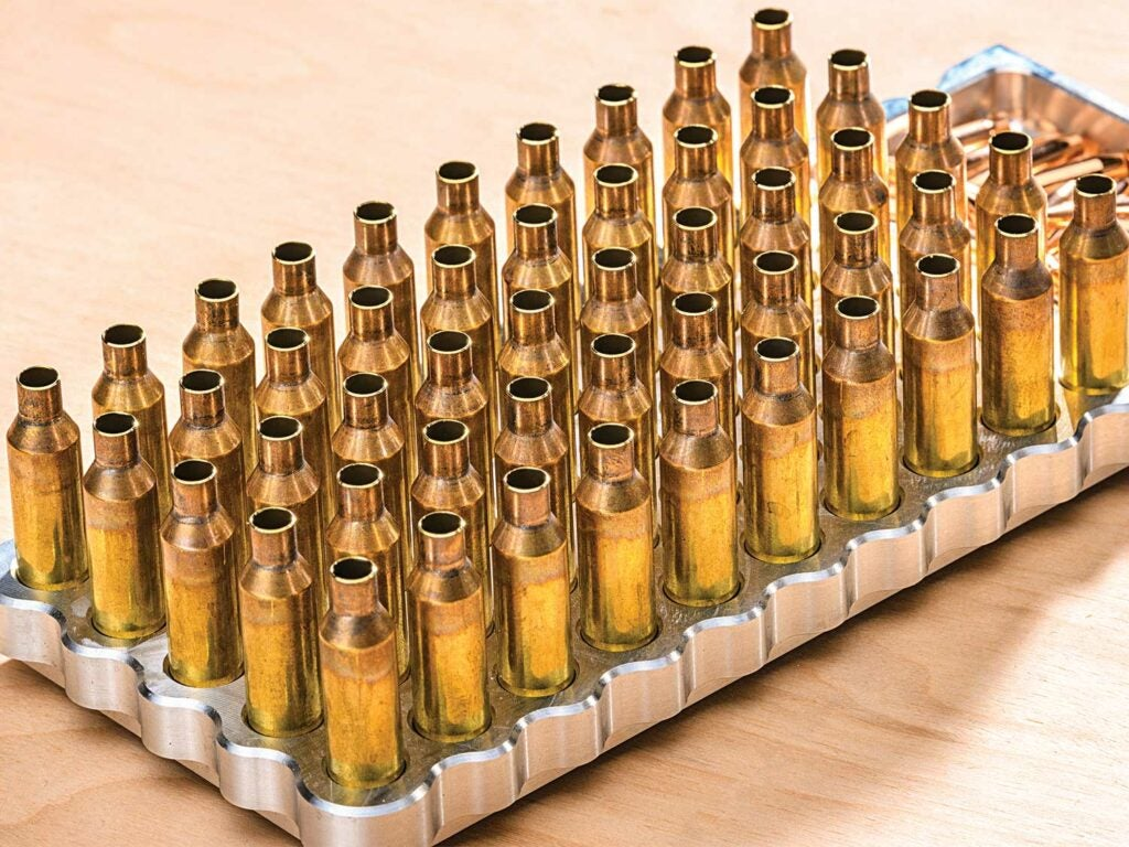 a tray of new brass ammo cartridges