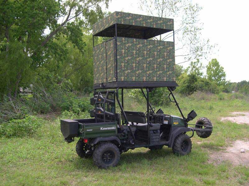 a critter gitter UTV with a rooftop hunting blind on top of it