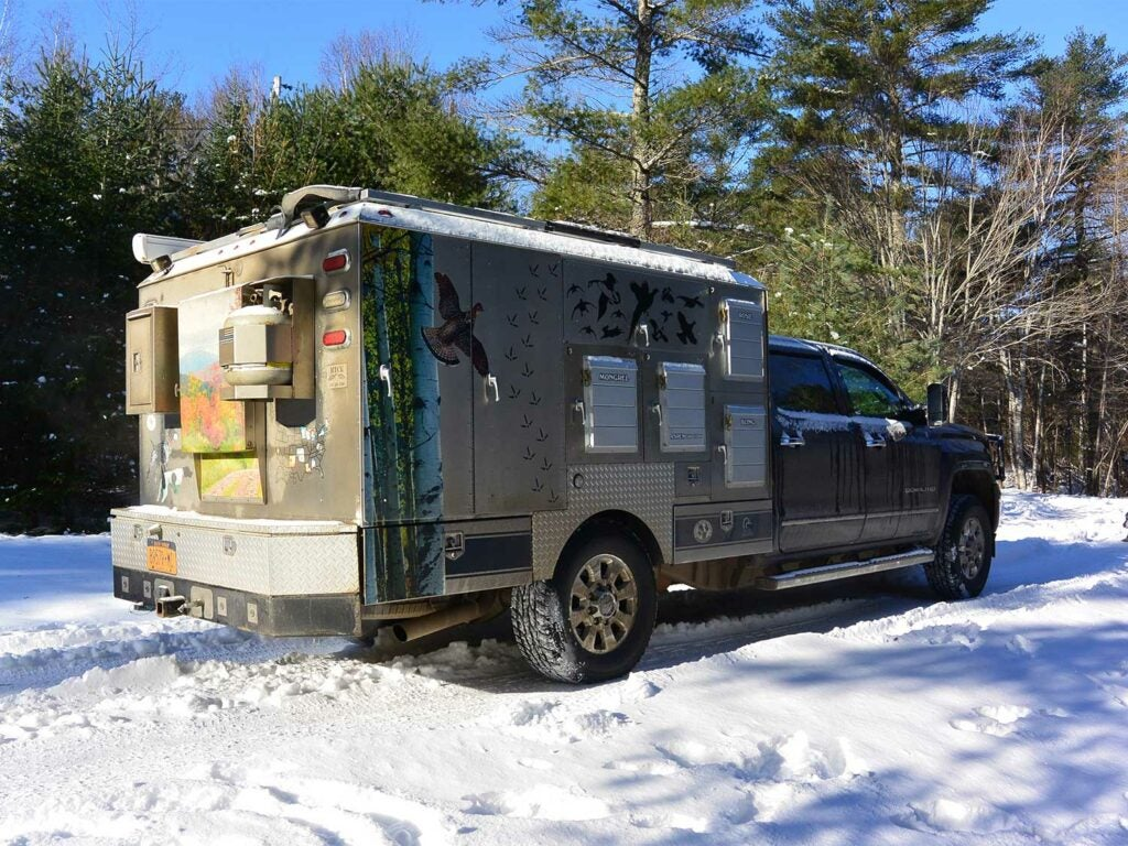 a custom hunting truck in the snow