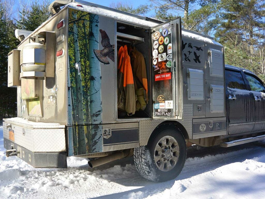 a custom built hunting truck with an open door