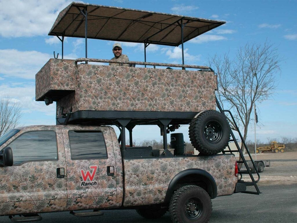 a camoflauge truck with a canopy