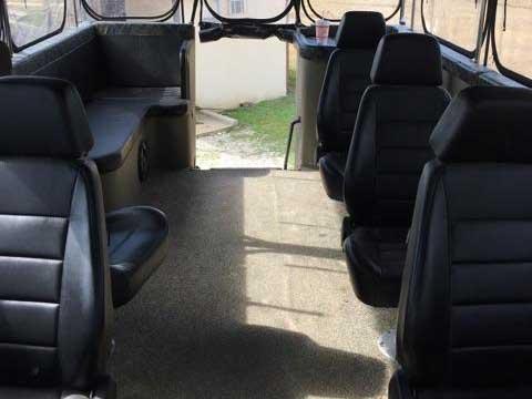 seats inside of a custom-built hunting truck