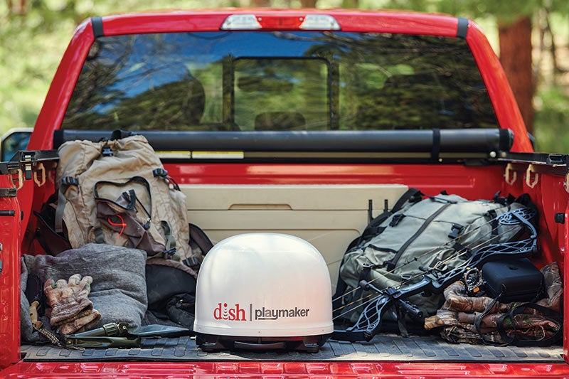 portable dish playmaker in the bed of a red truck