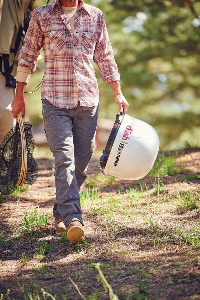 man carrying a dish playmaker