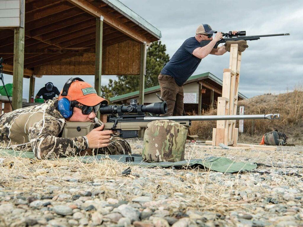 two men aiming rifles gun range