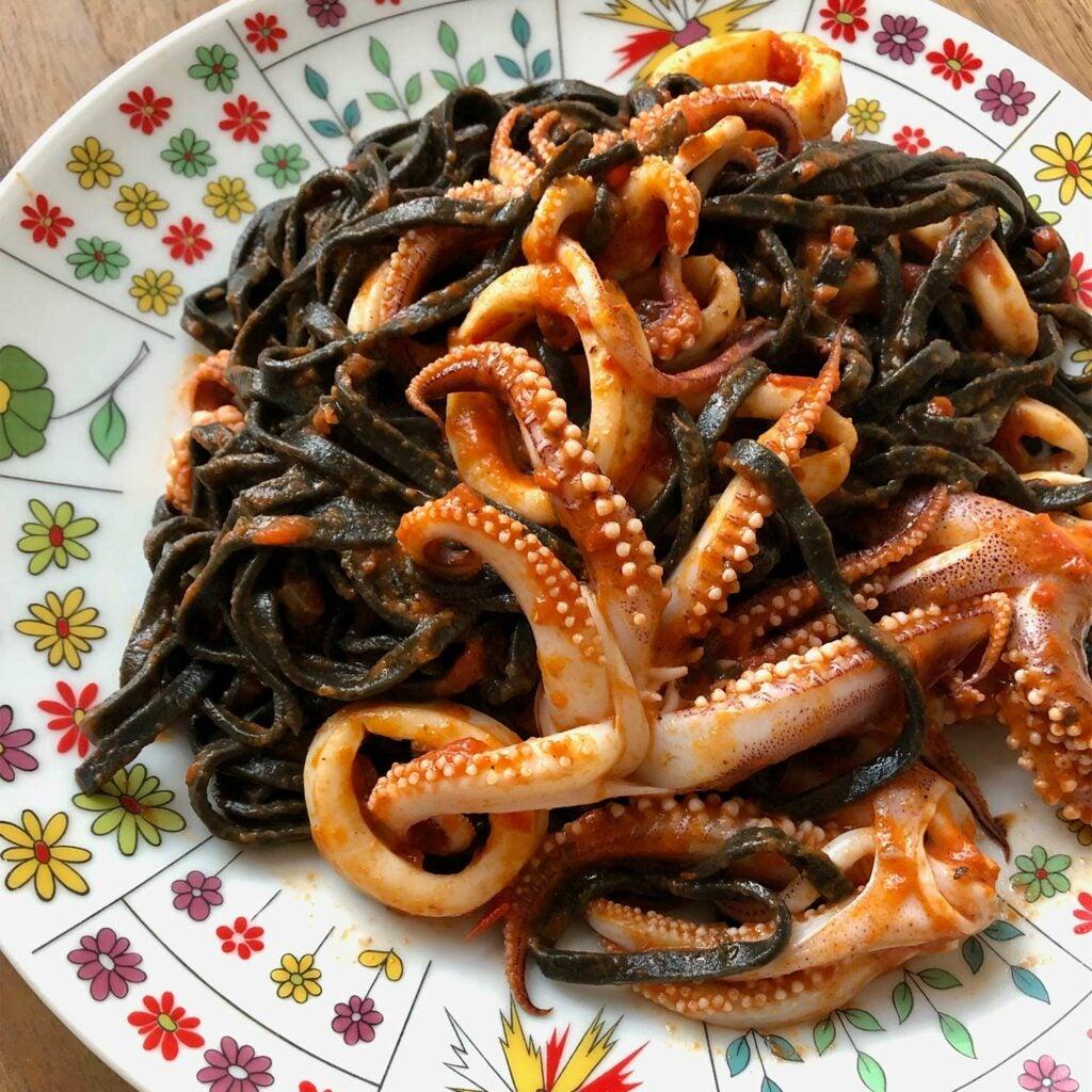 cooked calamari in squid ink and vodka sauce