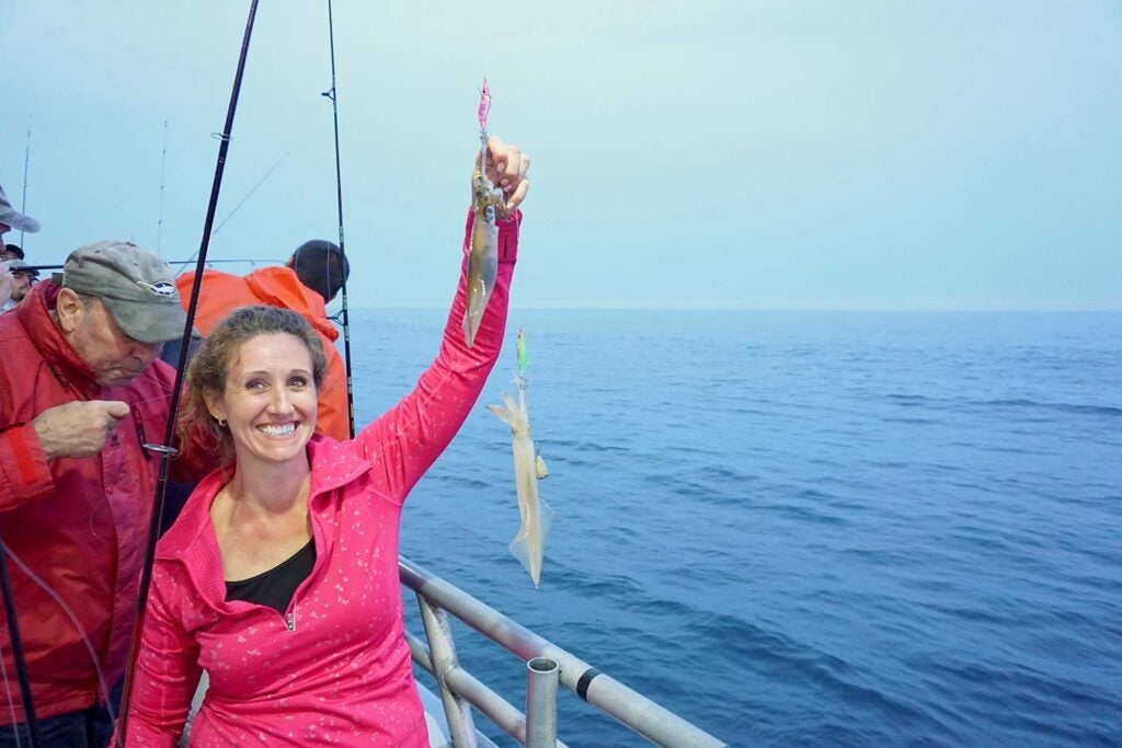 woman holding up a squid