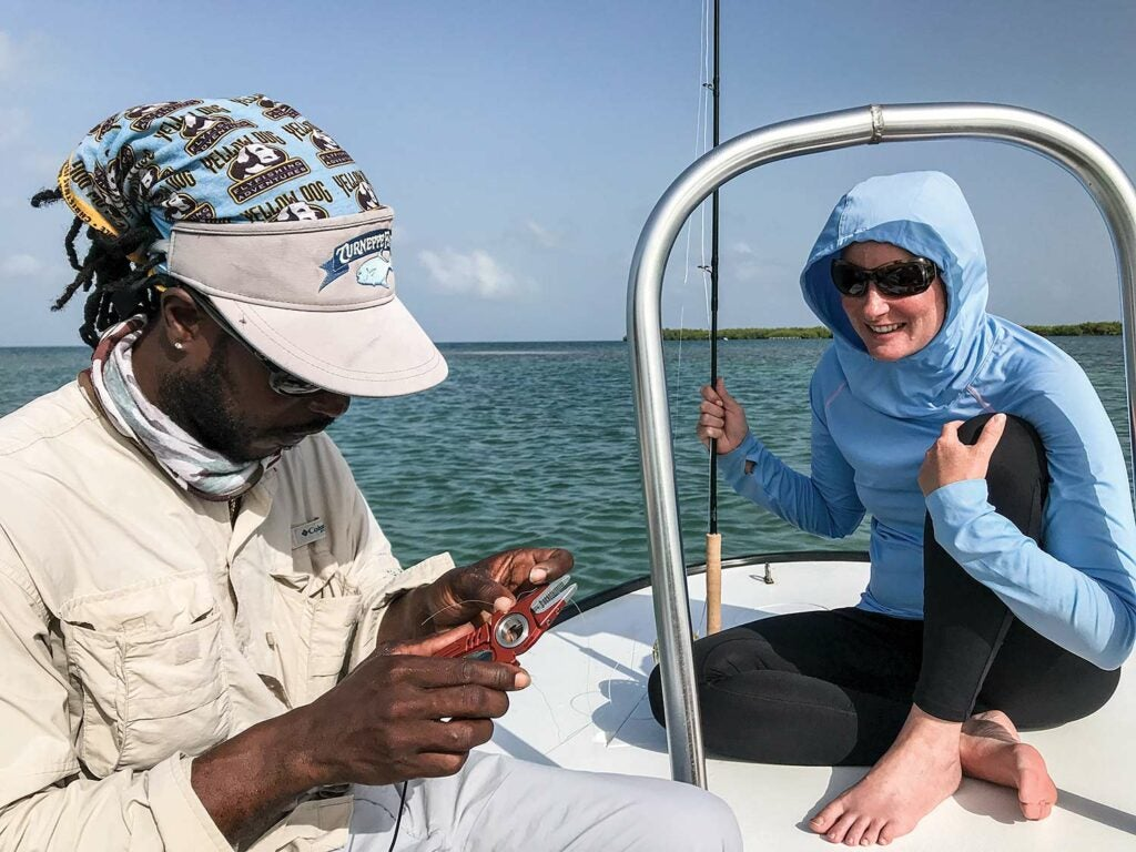 man tying a crab for saltwater fishing