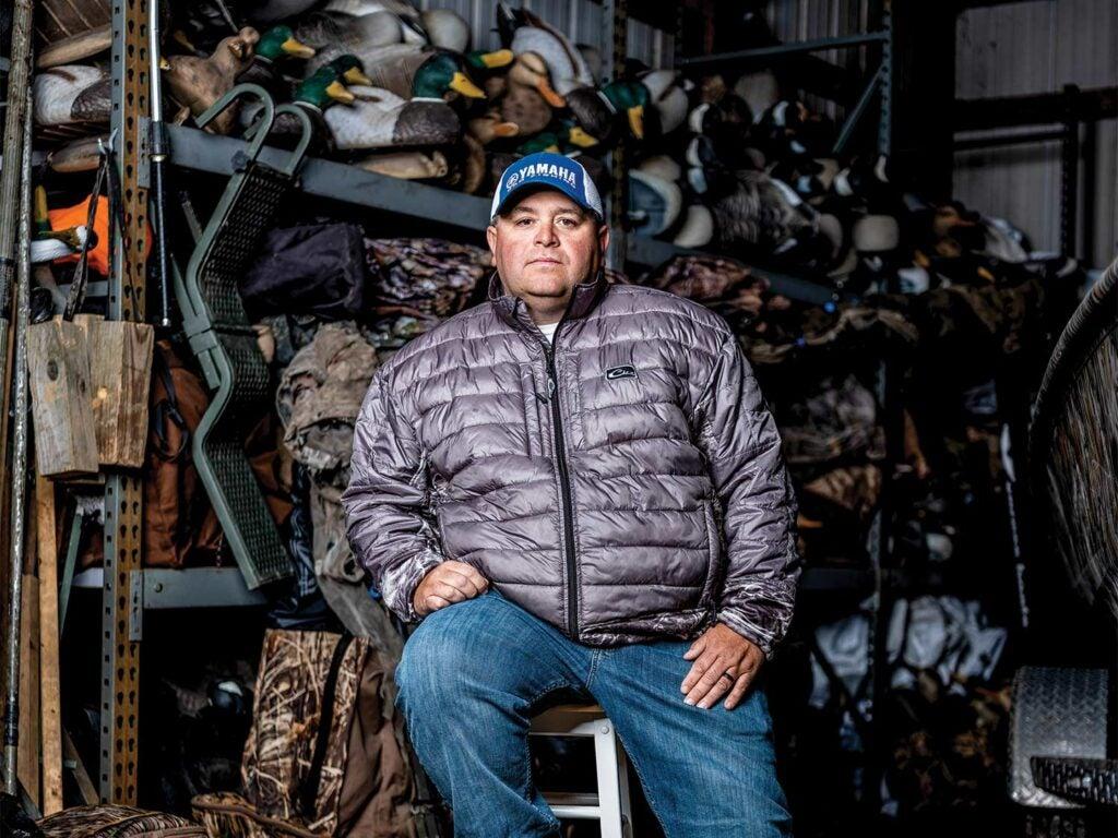 Bill Lowen sitting in his garage