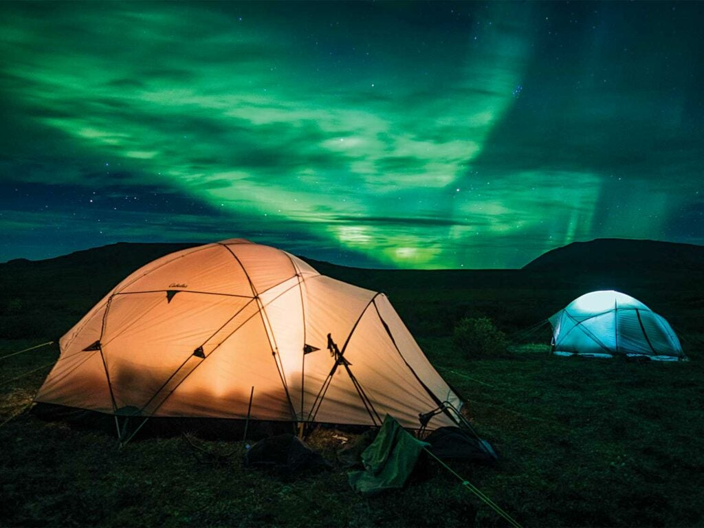 two base camp tents under the alaskan night sky