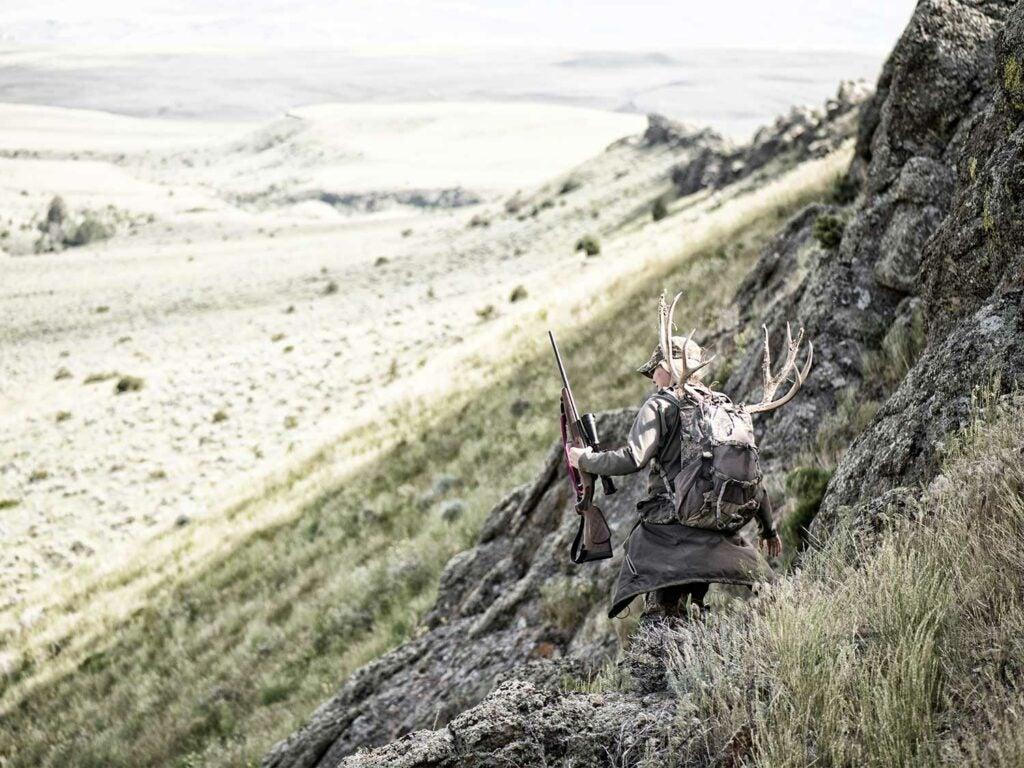 hunter hiking on hillside