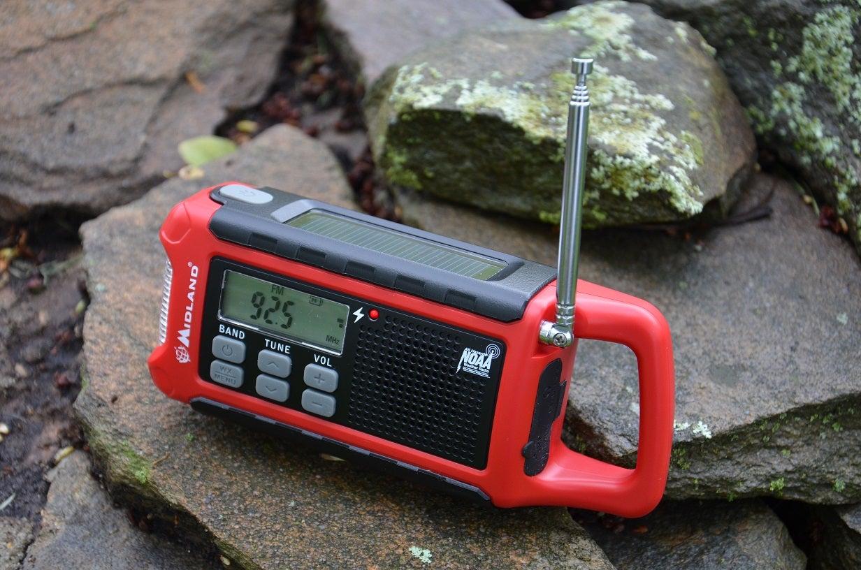 a red midland portable radio