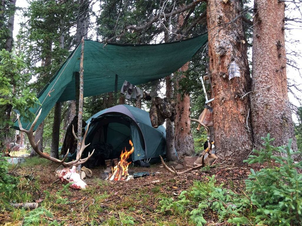 a tarp covering a camping tent