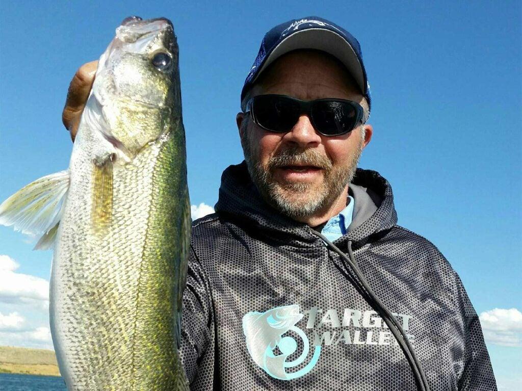 Jim Kalkofen holding a fish